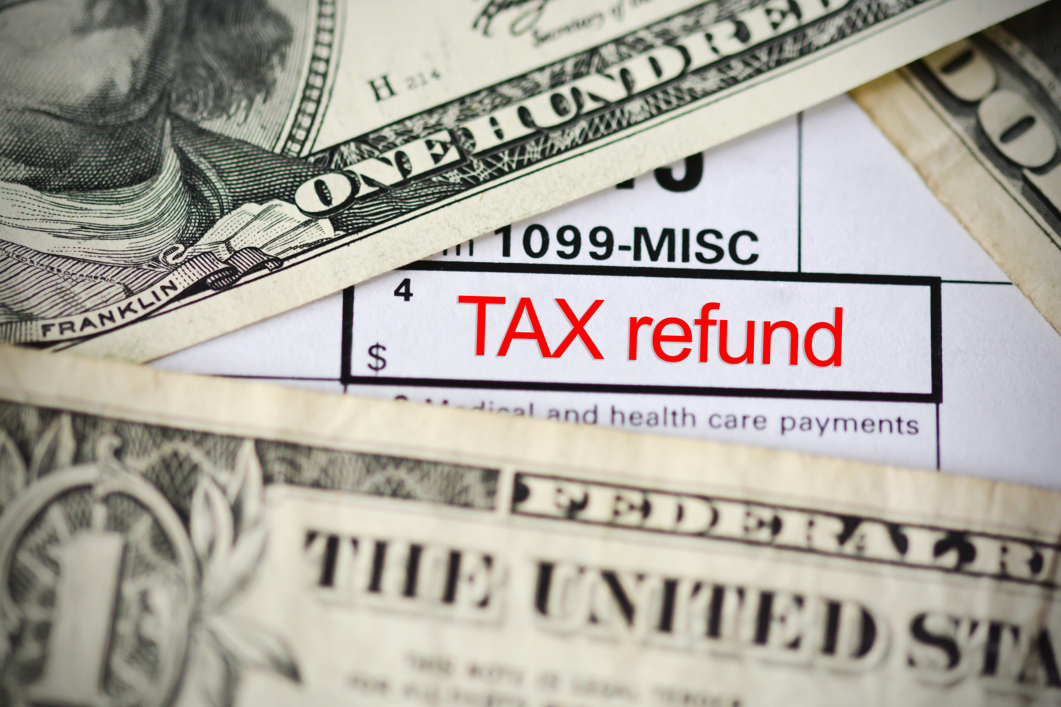Claim a tax refund concept with form template close up