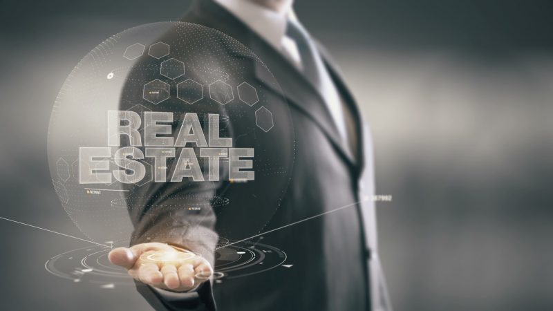 Real Estate Businessman Holding in Hand New technologies